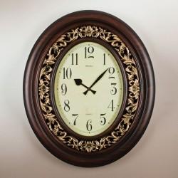 Ceas oval sculptat din lemn masiv
